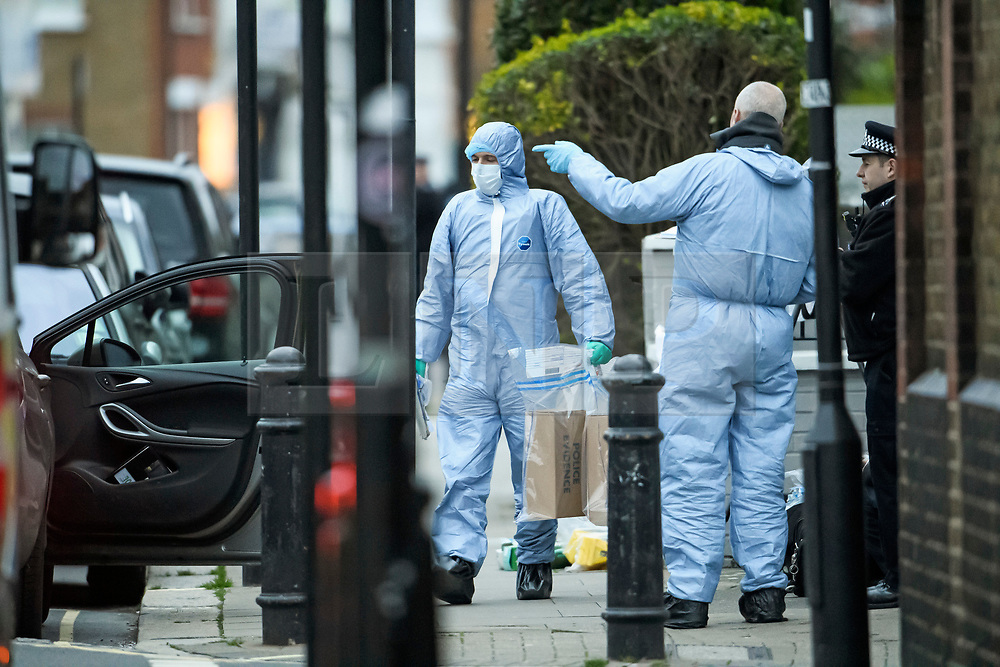 © Licensed to London News Pictures. 16/03/2019. London, UK. Police forensics carrying evidence at the scene where a 29 year old man has been stabbed to death on Gowan Avenue in Fulham, West London. Photo credit: Ben Cawthra/LNP