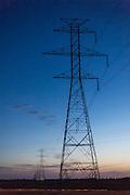 High voltage transmission wires at sunset