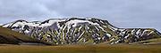 Green montain nearby Landmannalaugar, Iceland with snow. High resolution panorama | Grønt fjell med snøflekker i nærheten av Landmannalaugar, Island. Høyoppløselig panorama.