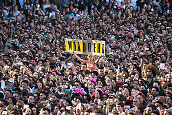 """© Licensed to London News Pictures . 04/06/2017 . Manchester , UK . A woman holds up a """" We Stand Together """" banner with Manchester worker bees stuck around the outside . The One Love Manchester benefit concert for victims of the Manchester Arena terrorist attack , at the Emirates Old Trafford Cricket Stadium . Ariana Grande, Justin Bieber, Coldplay, Katy Perry, Miley Cyrus, Pharrell Williams, Usher, Take That, Robbie Williams, Black Eyed Peas and Niall Horan are amongst the performers. Photo credit : Joel Goodman/LNP"""
