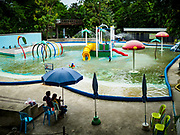 17 AUGUST 2018 - BANGKOK, THAILAND:   The swimming pool in Dusit Zoo in Bangkok. The zoo opened in 1938. The zoo grounds were originally the Dusit Royal Garden. The zoo is scheduled to close by the end of August 2018 because it is being relocated to Nakhon Pathom province, south of Bangkok.     PHOTO BY JACK KURTZ