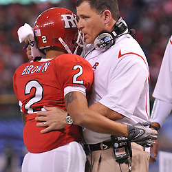 Dec 19, 2009; St. Petersburg, Fla., USA; Rutgers head coach Greg Schiano congratulates wide receiver Tim Brown (2) on a touchdown reception during NCAA Football action in Rutgers' 45-24 victory over Central Florida in the St. Petersburg Bowl at Tropicana Field.