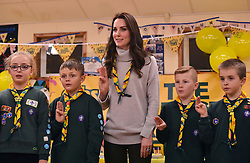 Duchess of Cambridge reads the Scouts promise during a Cub Scout Pack meeting with cubs from the Kings Lynn District, in Kings Lynn at the The Scout and Guide Hut in North Wootton, near King's Lynn, for an event to celebrate 00 years of the Cub Scout movement.