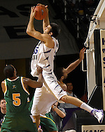 Kansas State center Jason Bennett (55) pulls down a rebound over Cleveland State's Victor Morris in the first half at Bramlage Coliseum in Manhattan, Kansas, December 5, 2006.  K-State beat the Vikings 93-60.<br />