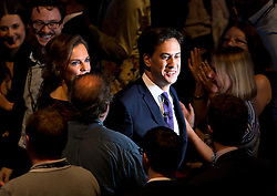 © London News Pictures. 24/09/2013 . Brighton, UK.   Labour party leader ED MILIBAND and wife JUSTINE THORNTON leave the stage after delivering his Key-note speech on the third day of the Labour Party Conference in Brighton. Photo credit : Ben Cawthra/LNP