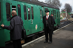 © Licensed to London News Pictures. 07/03/2014. Hampshire, UK. A station porter at Ropley Station today, 7th March 2014, which is the first day of the 'spring steam gala' on the Watercress Line. The railway line, operated by Mid Hants Railway Ltd, passes between Alresford and Alton in Hampshire. The line is named after its use in the past for transporting freshly cut watercress from the beds surrounding Alresford to London. Photo credit : Rob Arnold/LNP
