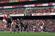 Per Mertersacker of Arsenal (L) wins a header in the air. Premier league match, Arsenal v Swansea city at the Emirates Stadium in London on Saturday 28th October 2017.<br /> pic by Steffan Bowen, Andrew Orchard sports photography.