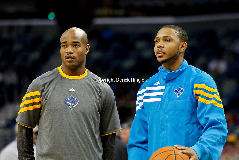 December 21, 2011; New Orleans, LA, USA; New Orleans Hornets point guard Jarrett Jack (right) and shooting guard Eric Gordon (left) prior to a game against the Memphis Grizzlies at the New Orleans Arena.   Mandatory Credit: Derick E. Hingle-US PRESSWIRE