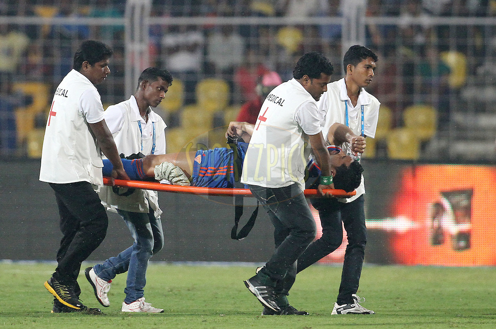 Andre Santos of FC Goa been taken on a stretcher after being injured during match 18 of the Hero Indian Super League between FC Goa and Delhi Dynamos FC held at the Jawaharlal Nehru Stadium, Fatorda, India on the 1st November 2014.<br /> <br /> Photo by:  Vipin Pawar/ ISL/ SPORTZPICS