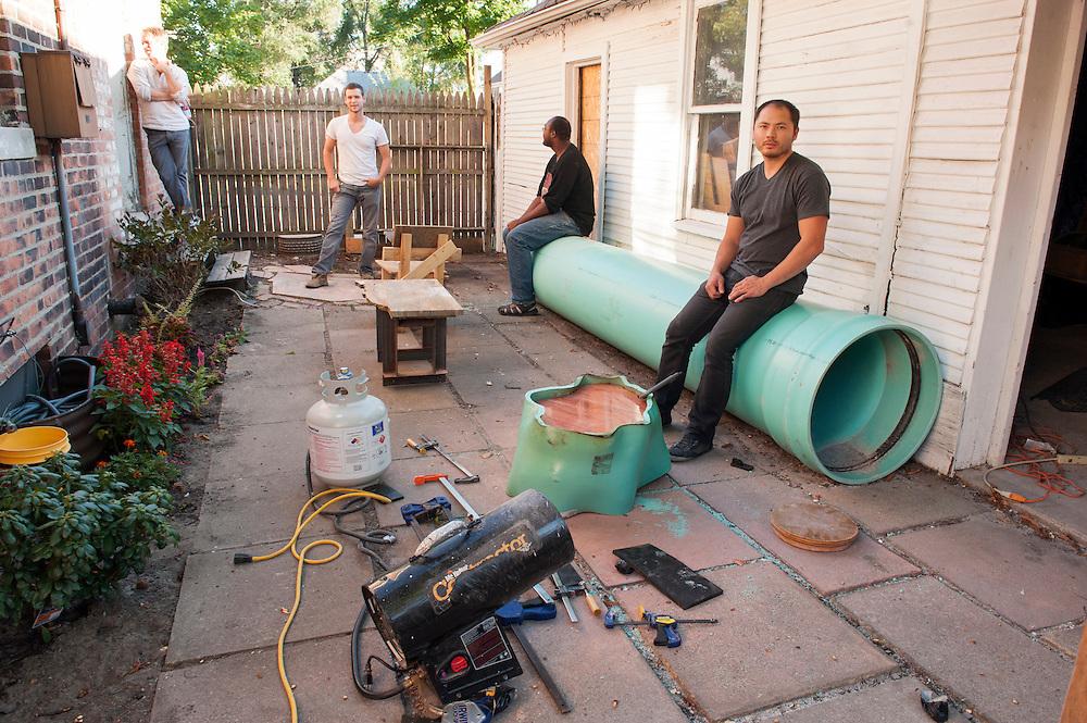 Artist Jack Craig, front, builds tables from huge plastic pipesin Detroit, Michigan.<br /> <br /> Art in Detroit 2013<br /> &copy; Stefan Falke<br /> www.stefanfalke.com