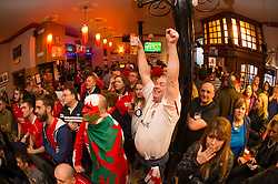 © London News Pictures. 12/03/2016 Aberystwyth, Wales, UK. Brave Englishman JOHN HARRINGTON celebrates with Welsh rugby fans in the Castle Hotel Aberystwyth, watching television coverage of Wales playing England in the Six Nations rugby international series. Photo credit: Keith Morris/LNP