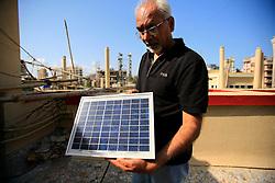 INDIA MUMBAI 30MAY10 - Brothers Amin and Mustafa Gilani present their solar thermal water heating installation on the roof of their apartment block in Juhu District, Mumbai, India...jre/Photo by Jiri Rezac..© Jiri Rezac 2010