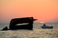 People enjoy the warm weather as the sun sets over the sunken concrete ship Sunday, October 30, 2016 at Sunset Beach in Cape May Point, New Jersey. (Photo by William Thomas Cain/Cain Images)
