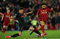 Football - 2019 / 2020 UEFA Champions League - Round of Sixteen, Second Leg: Liverpool (0) vs. Atletico Madrid (1)<br /> <br /> Liverpool's Mohamed Salah is tackled by Jose Gimenez of Atletico Madrid , at Anfield.<br /> <br /> <br /> COLORSPORT/TERRY DONNELLY
