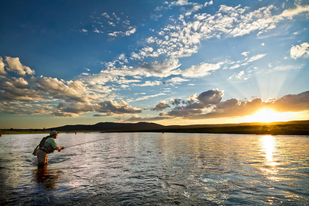 An angler makes a last cast near sunset on the Henry's Fork River in Idaho.