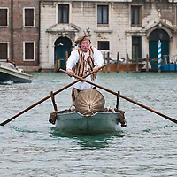 VENICE, ITALY - FEBRUARY 20:  A rawer wearing a traditional fisherman costume raws along the Grand Canal during the Venetian Feast on February 20, 2011 in Venice, Italy. During the Venetian Feast a traditional water parade sails from San Marco along the Canal Grande to the  district of Cannaregio where there the crowd waits for the Svolo della Pantegana (flight of the mouse).
