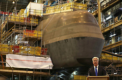 Defence Secretary Michael Fallon speaks in front of HMS Audacious at BAE Systems, Burrow-in-Furness, where he attended a steel-cutting ceremony to formally commence production of the UK's next generation of nuclear submarines.