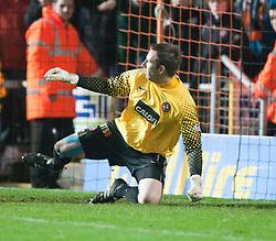 Dundee Utd's keeper misses FAlkirk's last penalty Stewart Murdoch..Falkirk win on penalties. Dundee Utd 2 v 2 Falkirk. Scottish Communities League Cup, 25/10/2011..Pic © Michael Schofield.