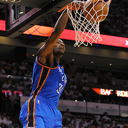 Jun 17, 2012; Miam, FL, USA; Oklahoma City Thunder small forward Kevin Durant (35) dunks against the Miami Heat during the first quarter in game three in the 2012 NBA Finals at the American Airlines Arena. Mandatory Credit: Derick E. Hingle-US PRESSWIRE