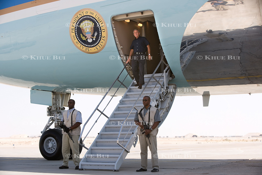 President Bush deboards Air Force One under tight security at Al-Asad Airbase in western Iraq Monday, September 3, 2007.  The clandestine trip, Bush's third to the country, was shortly before Gen. Petraeus and Ambassador Crocker are scheduled to deliver their assessments of the US troop surge to Congress...Photo by Khue Bui