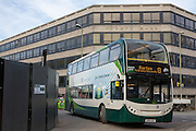 Electric hybrid green number 8 bus drives past the County Hall in Oxford, England, United Kingdom.  Stagecoach hybrid buses are more environmentally greener than traditional buses using 30% fuel and third less CO2 emissions, the buses are also much quieter.  (photo by Andrew Aitchison / In pictures via Getty Images)