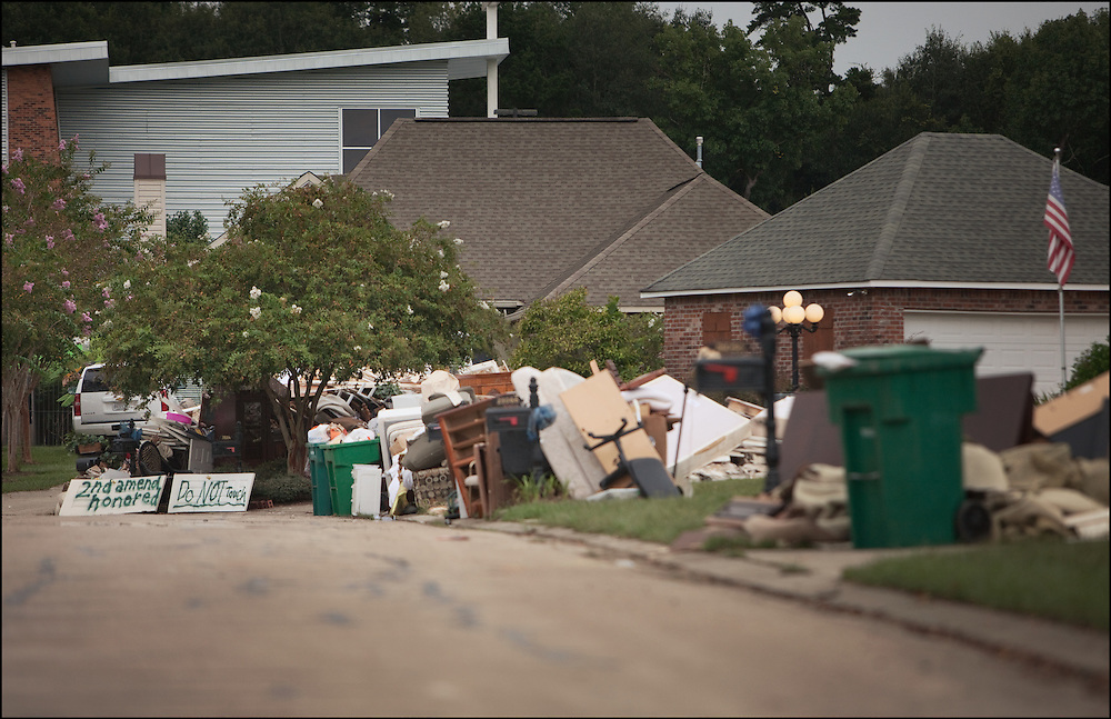 Household belongings scattered down the streets of Walker, Louisiana after major flooding recked havoc through the town.