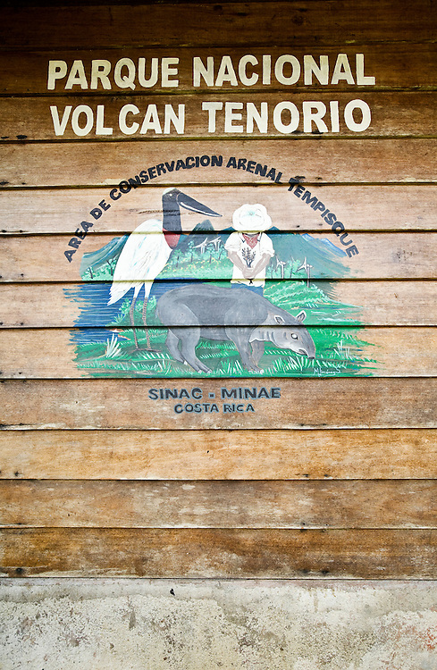 A hand painted sign announces the entrance to the Tenorio National Park in Costa Rica.