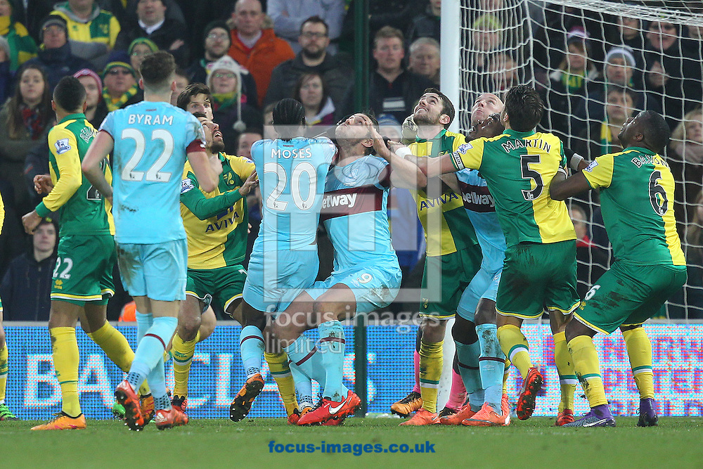 A crowd of player s from both sides watch the ball closely as they wait for it to come down from a high cross during the Barclays Premier League match at Carrow Road, Norwich<br /> Picture by Paul Chesterton/Focus Images Ltd +44 7904 640267<br /> 13/02/2016