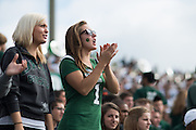 OHIO students Ariel Stiggers (Right) and Jenna Ellerbrook (Left) support their team at the 2013 Homecoming football game. Photo by Ben Siegel