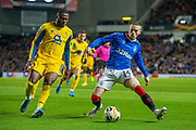 Ryan Kent (#14) of Rangers FC shields the ball from Chancel Mbemba (#19) of FC Porto during the Group G Europa League match between Rangers FC and FC Porto at Ibrox Stadium, Glasgow, Scotland on 7 November 2019.