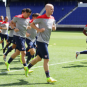 Michael Bradley, (centre), warms up with team mates during the US Mens National Team training at Red Bull Arena in preparation for Sunday's game against Turkey as they prepare for the 2014 FIFA World Cup. Red Bull Arena, Harrison, New Jersey, USA. 30th May 2014. Photo Tim Clayton