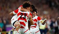 Rugby Union - 2019 Rugby World Cup - Pool A: Japan vs. Scotland<br /> <br /> Yu Tamura, Rikiya Matsuda and Ryohei Yamanaka of Japan celebrate at full time at International Stadium Yokohama, Kanagawa Prefecture, Yokohama City.<br /> <br /> COLORSPORT/LYNNE CAMERON