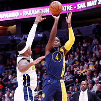 03 April 2018: Indiana Pacers guard Victor Oladipo (4) takes a jump shot over Denver Nuggets guard Torrey Craig (3) during the Denver Nuggets 107-104 victory over the Indiana Pacers, at the Pepsi Center, Denver, Colorado, USA.