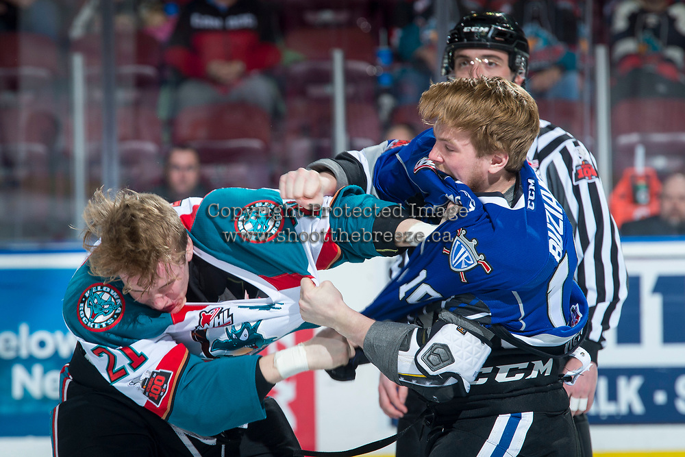 KELOWNA, CANADA - FEBRUARY 12: Kyle Pow #21 of the Kelowna Rockets drops the gloves with Braydon Buziak #10 of the Victoria Royals during first period on February 12, 2018 at Prospera Place in Kelowna, British Columbia, Canada.  (Photo by Marissa Baecker/Shoot the Breeze)  *** Local Caption ***