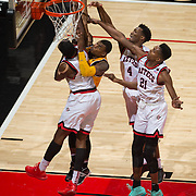 31 January 2017:  The San Diego State Aztecs men's basketball team hosts Wyoming Tuesday night at Viejas Arena. San Diego State center Valentine Izundu (45) guard Dakar Allen (4) and forward Malik Pope (21) attempt to block a shot from a Wyoming shooter in the first half. The Aztecs lead the Cowboys 31-27 at half time. www.sdsuaztecphotos.com