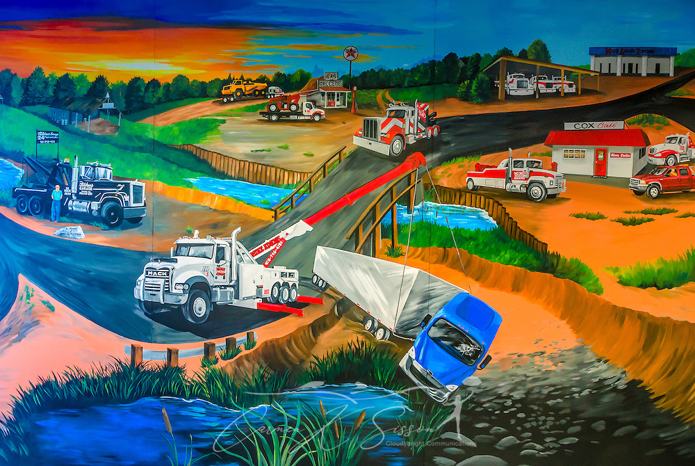 A mural, located on the wall at Mike Adams Towing and Air Cushion Recovery, depicts the life of the company, March 22, 2016, in Macon, Georgia. Mike Adams started his business with a 1993 with a 1989 Mack Super-Liner. Today, he owns 27 towing and recovery trucks, nearly a third of which are Macks. (Photo by Carmen K. Sisson/Cloudybright)