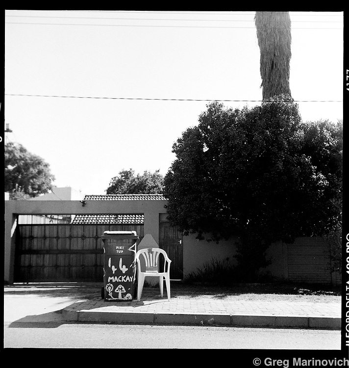 Portrait of a white plastic chair #5, Blairgowrie, Johannesburg, South Africa, 2007. Photograph by Greg Marinovich