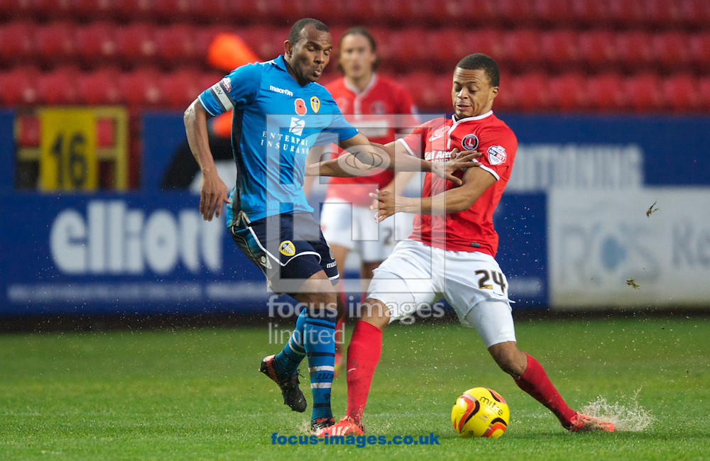 Picture by Alan Stanford/Focus Images Ltd +44 7915 056117<br /> 09/11/2013<br /> Jordan Cousins of Charlton Athletic and Rudolph Austin of Leeds United during the Sky Bet Championship match at The Valley, London.