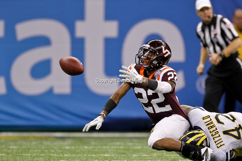 January 3, 2012; New Orleans, LA, USA; Virginia Tech Hokies kick returner Tony Gregory (22) fumbles as he is hit from behind by Michigan Wolverines linebacker J.B. Fitzgerald (42)during the second quarter of the Sugar Bowl at the Mercedes-Benz Superdome.  Mandatory Credit: Derick E. Hingle-US PRESSWIRE