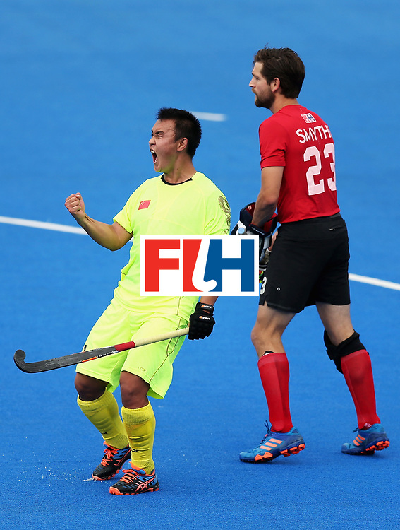 LONDON, ENGLAND - JUNE 24: Wei Wo of China celebrates scoring his sides third goal during the 5th-8th place match between Canada and China on day eight of the Hero Hockey World League Semi-Final at Lee Valley Hockey and Tennis Centre on June 24, 2017 in London, England.  (Photo by Alex Morton/Getty Images)