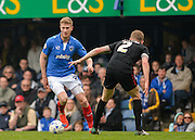 Portsmouth forward Michael Smith takes on Carlisle United Defender Tom Miller during the Sky Bet League 2 match between Portsmouth and Carlisle United at Fratton Park, Portsmouth, England on 2 April 2016. Photo by Adam Rivers.