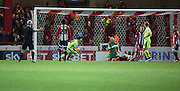 Huddersfield Town striker Joe Lolley scoring shortly after the second half kicked off during the Sky Bet Championship match between Brentford and Huddersfield Town at Griffin Park, London, England on 19 December 2015. Photo by Matthew Redman.