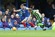 Dannie Bulman of AFC Wimbledon, Ben Davies battle during the Sky Bet League 2 match between Portsmouth and AFC Wimbledon at Fratton Park, Portsmouth, England on 15 November 2015. Photo by Stuart Butcher.