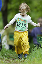 "(Kingston, Ontario---16/05/09) ""Charlotte Brooks running in the kids race at the 2009 Salomon 5 Peaks Trail Running series Race held in Kingston, Ontario as part of the Eastern Ontario/Quebec division. ""  Copyright photograph Sean Burges / Mundo Sport Images, 2009. www.mundosportimages.com / www.msievents.com."