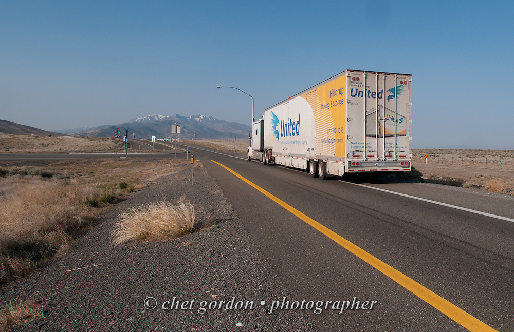 Over the road driver Jose Williams' truck is seen parked off Interstate 80 West during a brief stop in Imlay, NV on Monday, April 20, 2015. Williams, a cross country trucker with a national household moving company, made several delivery stops in central California's Bay Area during the week with loads that originated in Virginia on April 16th.  © Chet Gordon/THE IMAGE WORKS