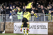 Harrogate Town defender Ryan Fallowfield (2) and Harrogate Town midfielder Lloyd Kerry (17) join Harrogate Town midfielder Michael Woods (21) celebrating Harrogate Town's third goalduring the Vanarama National League match between FC Halifax Town and Dover Athletic at the Shay, Halifax, United Kingdom on 17 November 2018.