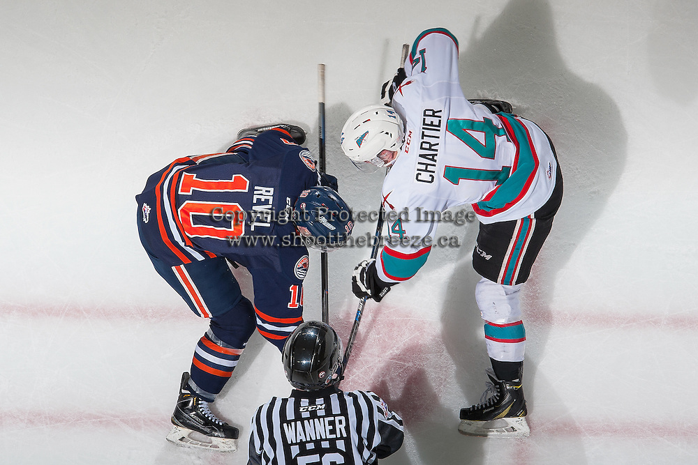 KELOWNA, CANADA - MARCH 11: Rourke Chartier #14 of Kelowna Rockets faces off against Matt Revel #10 of Kamloops Blazers on March 11, 2016 at Prospera Place in Kelowna, British Columbia, Canada.  (Photo by Marissa Baecker/Shoot the Breeze)  *** Local Caption *** Matt Revel; Rourke Chartier;