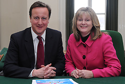 Leader of the Conservative Party David Cameron with Anne Main, Member of Parliament for St Albans in his office in Norman Shaw South, January 7, 2010. Photo By Andrew Parsons / i-Images.