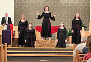 Jubilee members interpret Station Eleven, where Jesus is nailed to the cross, during a performance of 'The Way of the Cross' at St. Luke Catholic Parish in Beavercreek, Friday, March 30, 2012.  'The Way of the Cross' retraces 'the path Jesus walked on his way to Calvary.'