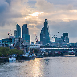 London ,UK - 24 April 2014: Dark cloud formations over the skyscrapers of The City minutes after sunrise.